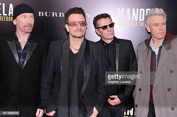 U2 band members The Edge Bono Larry Mullen Jr and Adam Clayton attend 'Mandela Long Walk To Freedom' screening hosted by U2 Anna Wintour Bob and...