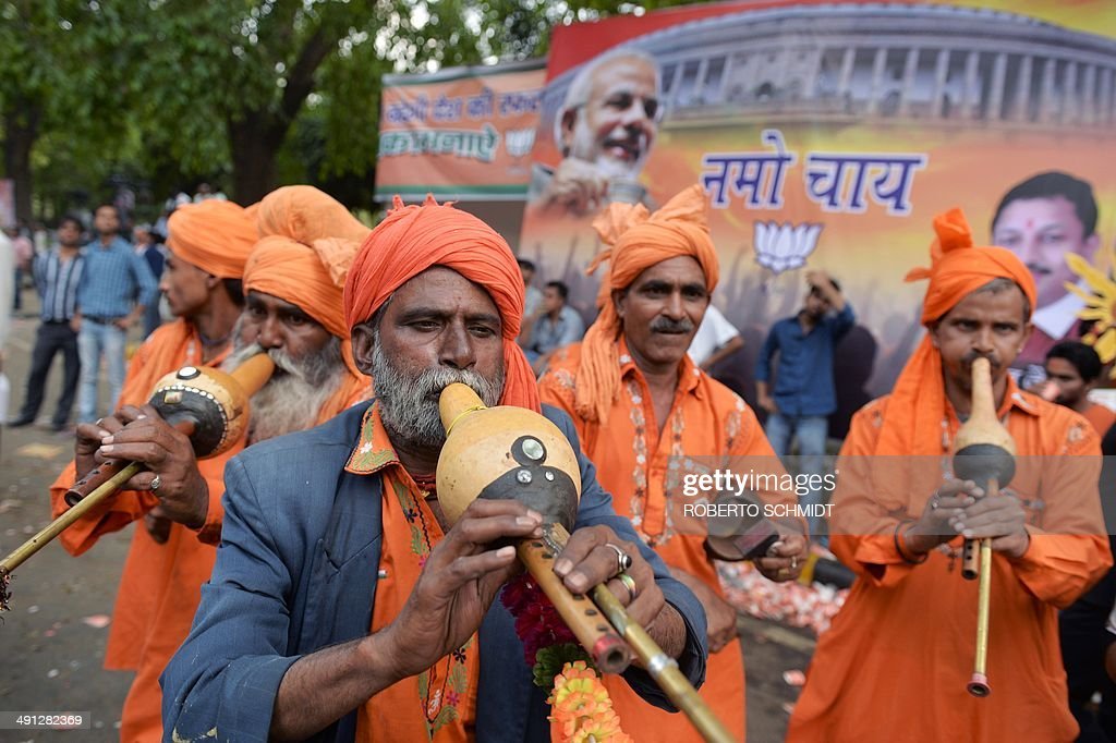 A band of Indian musicians plays music for a group of paying customers who wanted to dance as they celebrate at the Bharatiya Janata Party (BJP) headquarters in New Delhi on May 16, 2014. India's triumphant Hindu nationalists declared 'the start of a new era' in the world's biggest democracy after hardline BJP leader Narendra Modi propelled them to a stunning win on a platform of revitalizing the sickly economy.