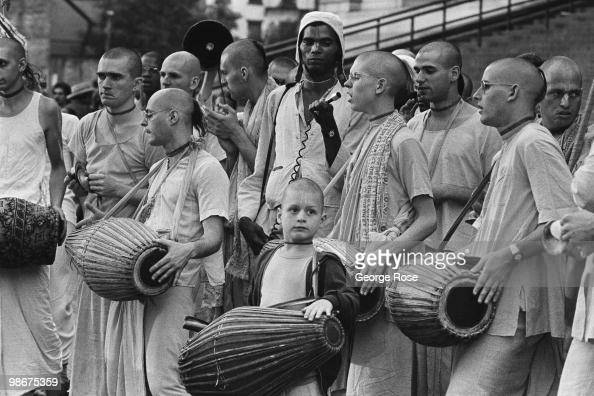 A band of singing and dancing Hare Krishna demonstrate outside on the street during the 1976 New York New York Democratic National Convention at...