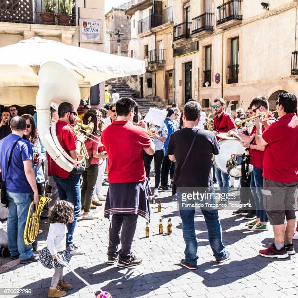 Band of street musicians playing in the public street in Sepulveda, Segovia (Spain)
