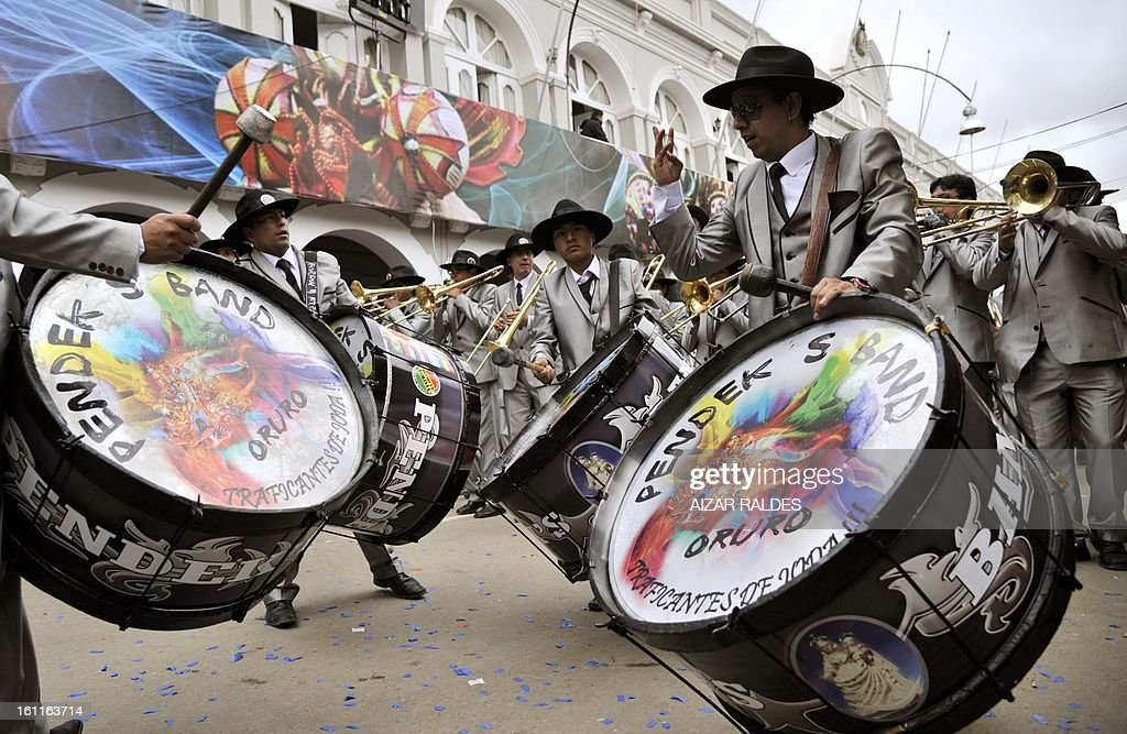 A band of the Morenada Central Cocanis de Oruro brotherhood take part in Carnival of Oruro, in the mining town of Oruro, 240 km south of La Paz on February 9, 2013. The Carnival of Oruro was inscribed by UNESCO on the Representative List of the Intangible Cultural Heritage of Humanity in 2008.