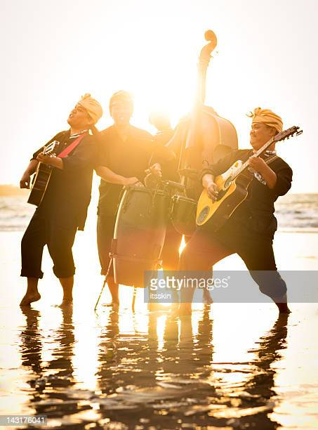 Band performing on the beach