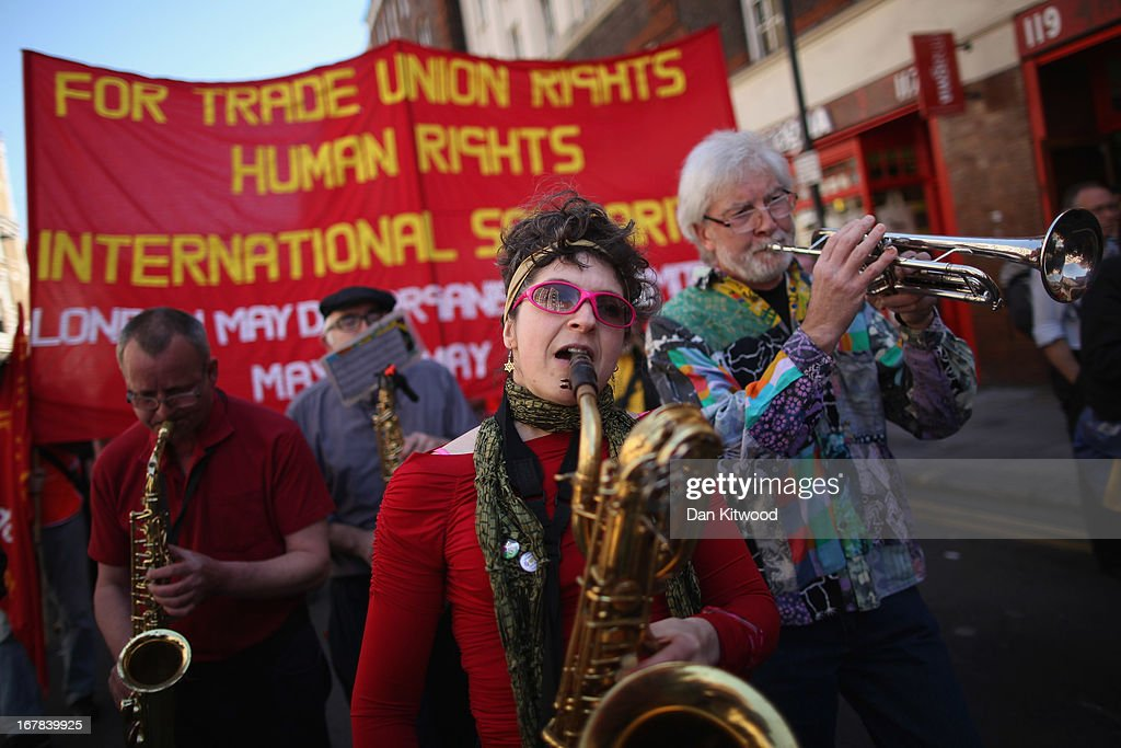 A band play during the annual May Day march on May 01, 2013 in London, England. Students, trade unionists, pensioners and activists staged a march through central London before gathering in Trafalgar Square to hear speeches.