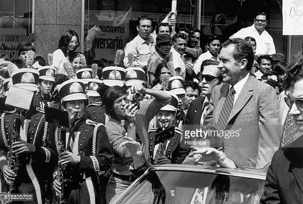 A band plays as President Nixon drives by during a campaign tour in Laredo Texas
