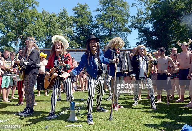 A band plays at the public openair swimming pool at the Wacken Open Air heavy metal music fest on August 2 2013 in Wacken Germany Approximately 75000...