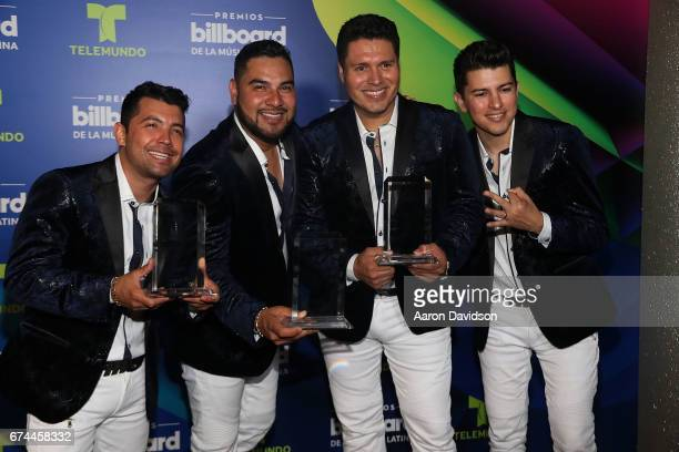 Band MS poses backstage during the Billboard Latin Music Awards at Watsco Center on April 27 2017 in Coral Gables Florida