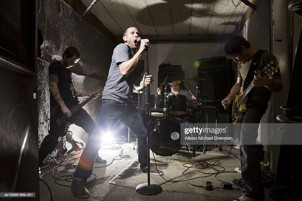 Band rehearsing in practice space : Stock Photo