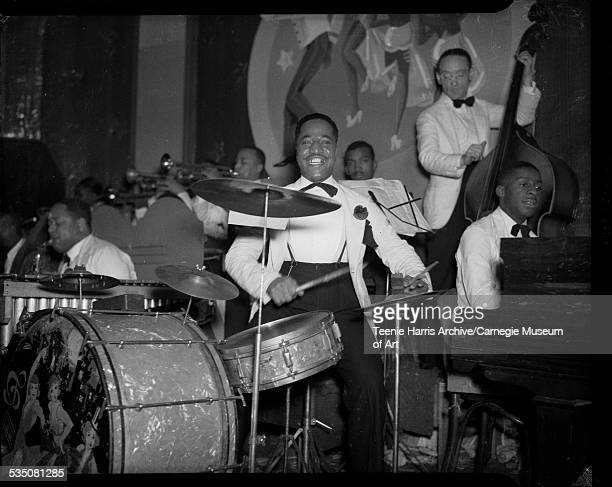 Band with Erroll Garner on piano James 'Honey Boy' Minor on drums George 'Ghost' Howell on bass and Joe Westray beside 'Ghost' in background...
