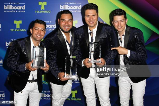 Banda MS pose with their awards in the press room during the Billboard Latin Music Awards at Watsco Center on April 27 2017 in Coral Gables Florida