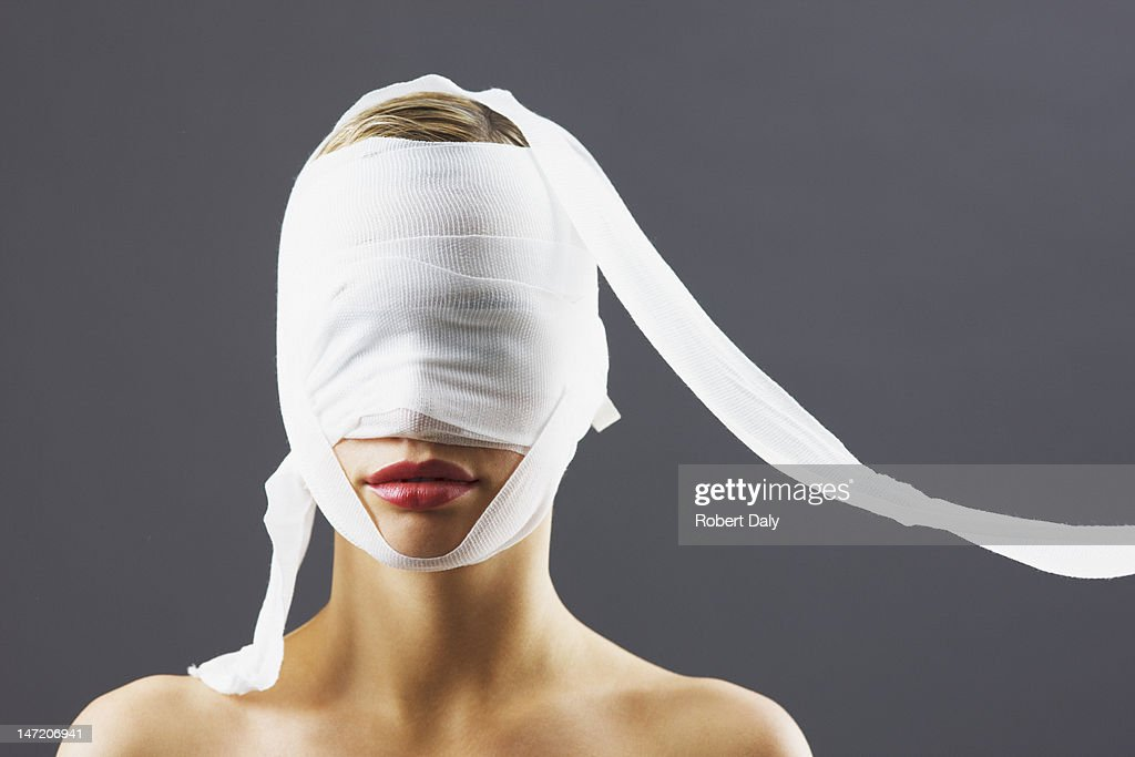 Bandage covering woman's face : Stock Photo