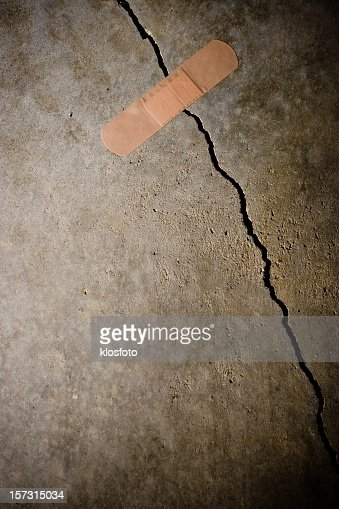 Bandage holding together a crack in the concrete