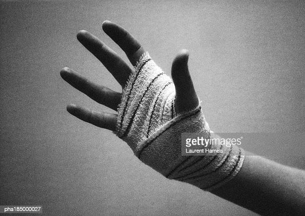 Bandaged hand, close-up, b&w