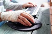 bandaged hand on mouse
