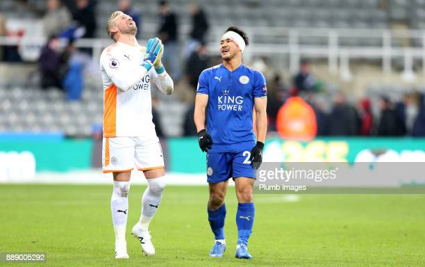 A bandaged up Shinji Okazaki of Leicester City with Kasper Schmeichel of Leicester City after the Premier League match between Newcastle United and...
