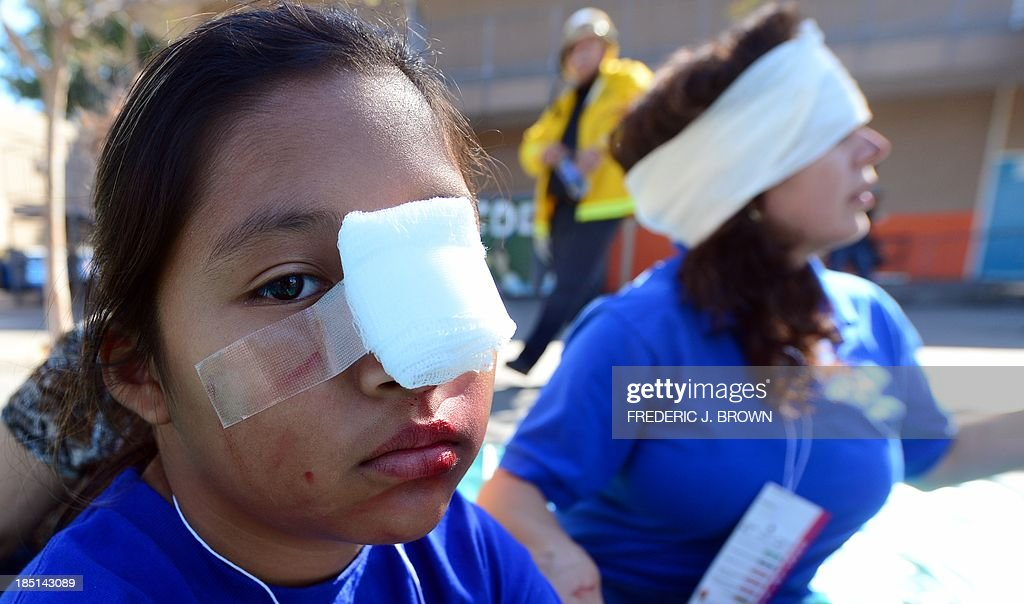 Bandages wrap and cover make-believe injuries during an earthquake drill at Rosemont Elementary School in Los Angeles on October 17, 2013. Millions of people across California were expected to 'drop, cover and hold on' in the earthquake drills staged across the state today in preparation for the 'Big One' expected to hit someday. AFP PHOTO/Frederic J. BROWN