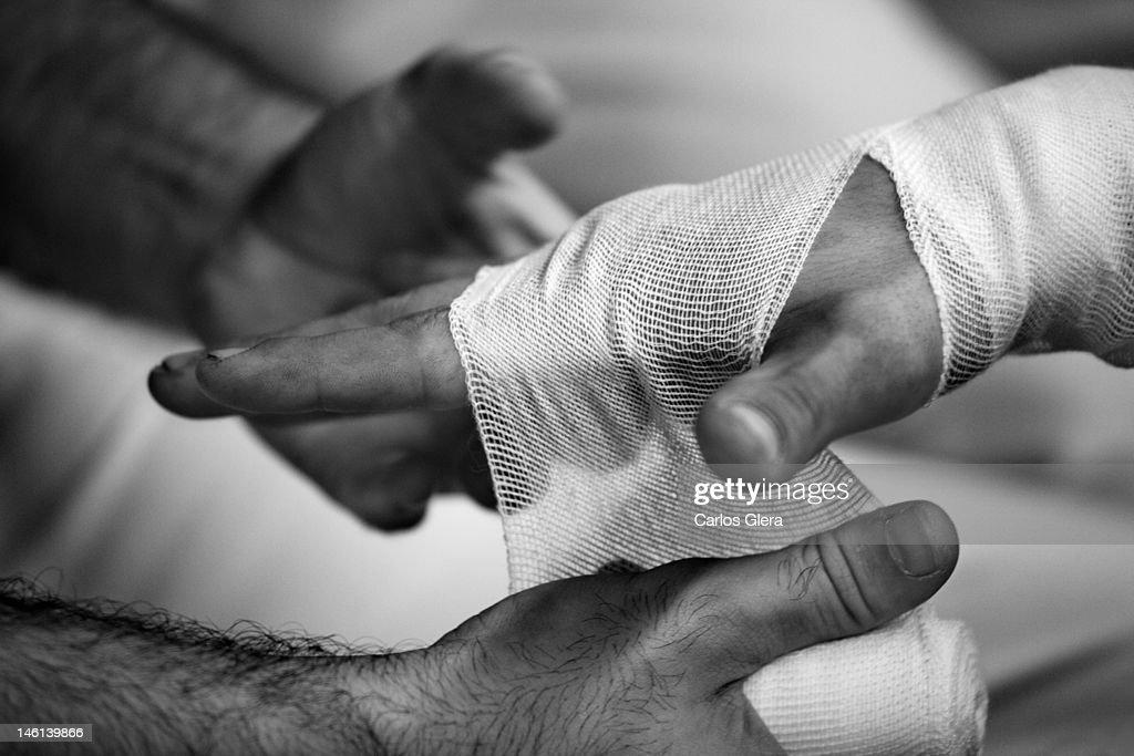 Bandaging hand : Stock Photo