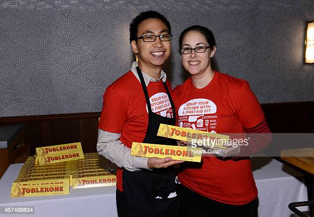 BandAid volunteers pose with Toblerone chocolate bars at Ample Hills Brooklyn's Best Dessert Party during the Food Network New York City Wine Food...