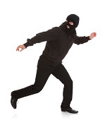 Man Wearing Mask Running Over White Background