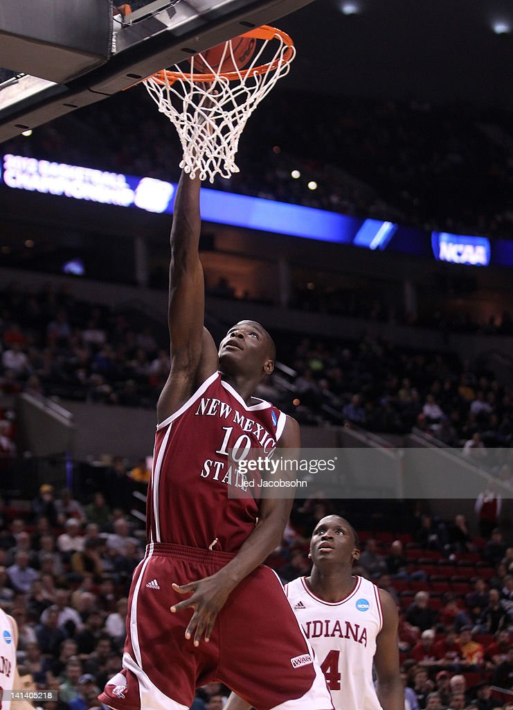Bandja Sy #10 of the New Mexico State Aggies lays the ball up in front of Victor Oladipo #4 of the Indiana Hoosiers in the second half in the second round of the 2012 NCAA men's basketball tournament at Rose Garden Arena on March 15, 2012 in Portland, Oregon.