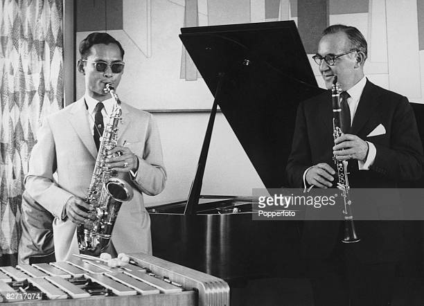 Bandleader and clarinetist Benny Goodman invites King Bhumibol of Thailand to his New York apartment for a jam session during the latter's tour of...