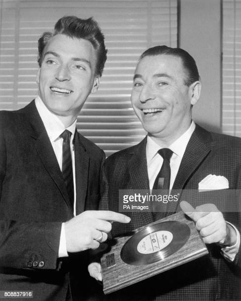 Bandleader Joe Loss with Australian singer Frank Ifield after Joe received a Gold Disc for his band's recording of 'Begin the Beguine' which has sold...