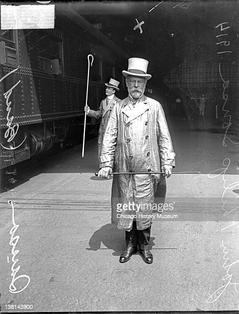 Bandmaster John Philip Sousa standing near a train car Chicago Illinois 1914 From the Chicago Daily News collection