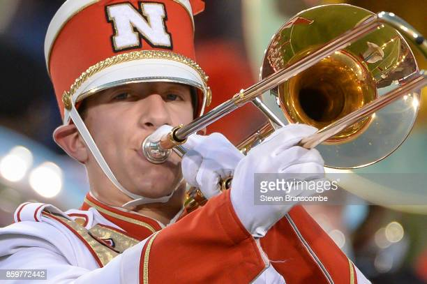 A bandmember of the Nebraska Cornhuskers performs before the game against the Wisconsin Badgers at Memorial Stadium on October 7 2017 in Lincoln...