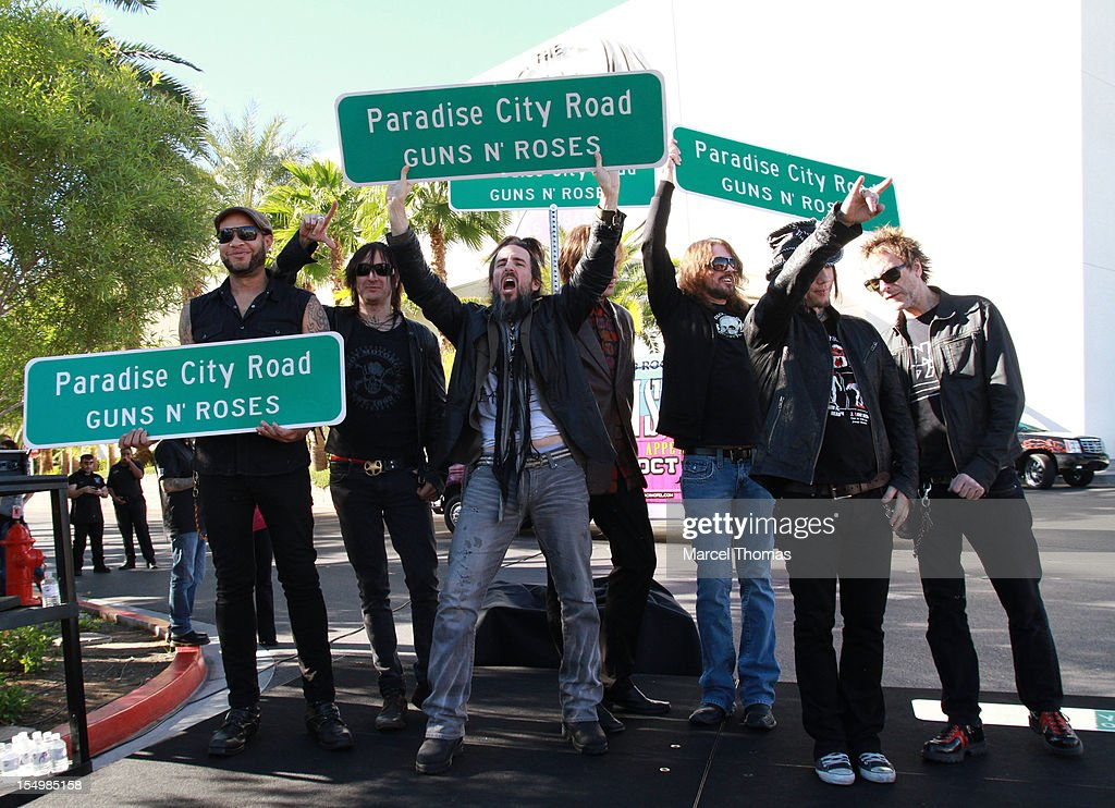 Bandmembers of Guns N' Roses join Clark County Commissioner Mary Beth Scow,Hard Rock Hotel COO Jody Lake and Director of Entertainent Paul Davis to rename Paradise Road as 'Paradise City Road' in honour of Guns N' Roses residency at Hard Rock Hotel and Casino on October 29, 2012 in Las Vegas, Nevada.