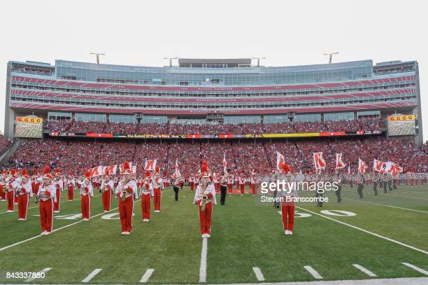 Bandmembers of the Nebraska Cornhuskers perform before the game against the Arkansas State Red Wolves at Memorial Stadium on September 2 2017 in...