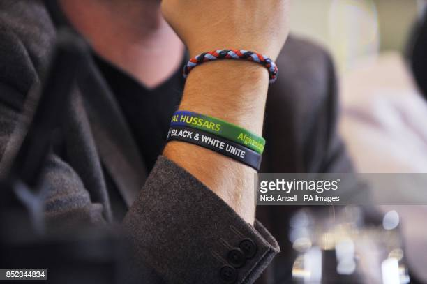 Bands on the wrist of English Defence League leader Tommy Robinson during a press conference at the Montague Hotel central London as he announces...