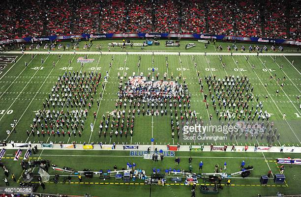 Bands perform during halftime of the ChickFilA Bowl between the Texas AM Aggies and the Duke Blue Devils at the Georgia Dome on December 31 2013 in...