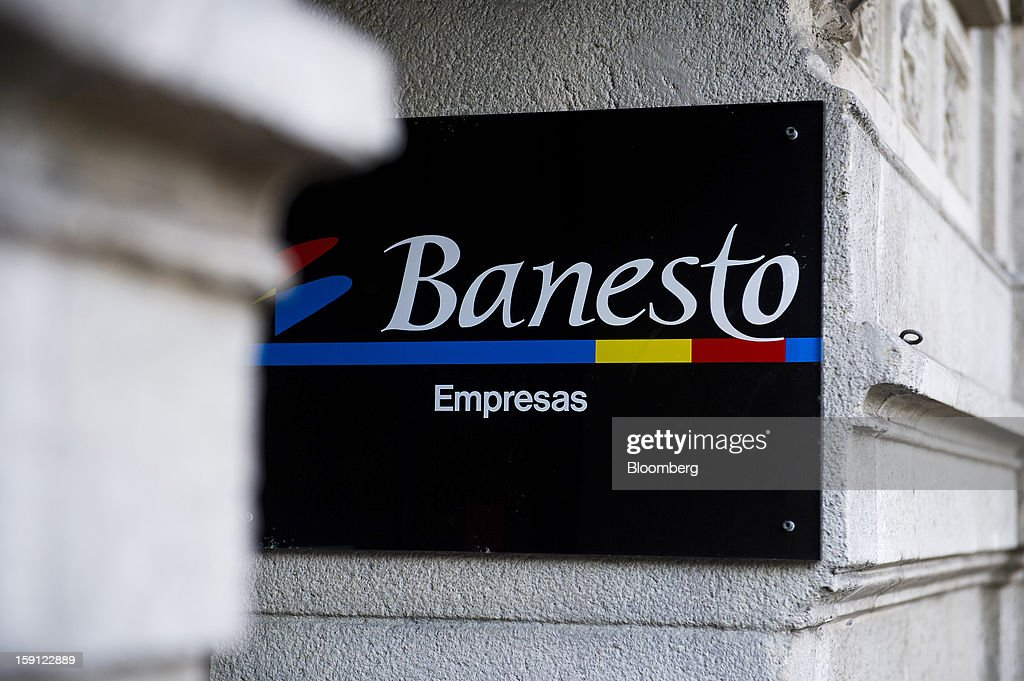 A Banesto logo sits on display outside the offices of Banco Espanol de Credito SA in Barcelona, Spain, on Tuesday, Jan. 8, 2013. Banco Santander SA, Spain's biggest lender, will offer 263 million euros ($345 million) in stock to buy out minority investors in its Banco Espanol de Credito SA retail unit and close 700 local branches to cut costs. Photographer: David Ramos/Bloomberg via Getty Images