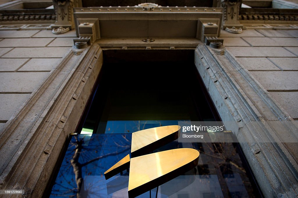 A Banesto logo sits on glass outside the offices of Banco Espanol de Credito SA in Barcelona, Spain, on Tuesday, Jan. 8, 2013. Banco Santander SA, Spain's biggest lender, will offer 263 million euros ($345 million) in stock to buy out minority investors in its Banco Espanol de Credito SA retail unit and close 700 local branches to cut costs. Photographer: David Ramos/Bloomberg via Getty Images