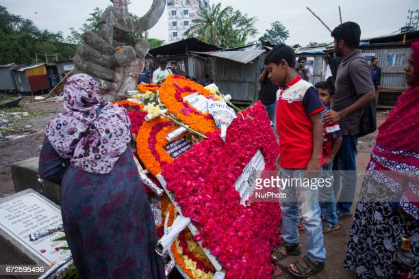 A Bangaldeshi relative of a victim killed in the quotRana Plazaquot building collapse paying tribute to a monument as he marks the fourth anniversary...