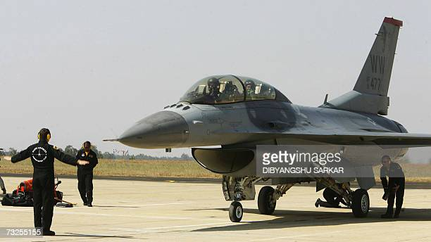 Chairman of India's Tata Group Ratan Tata sits inside a US made F16 aircraft as it taxis to a halt during the second day of the Aero India 2007 at...