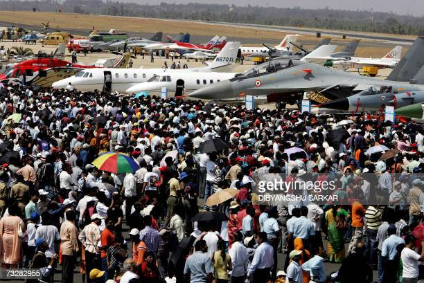 Crowds of spectators congregate around a static display area during the fourth day of Aero India 2007 at The Yelahanka Air Force Station in Bangalore...