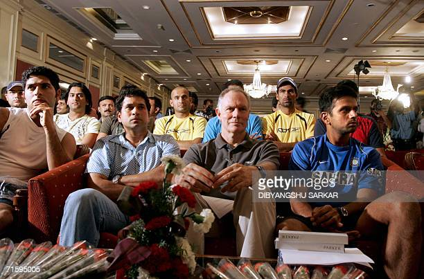 Indian cricketers Yuvraj Singh Sachin Tendulkar coach Greg Chappell and captain Rahul Dravid sit with teamates during a function in Bangalore 06...