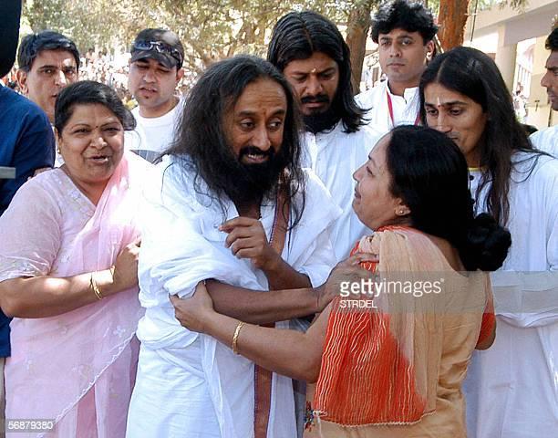 Indian founder of Art of Living foundation Sri Sri Ravi Shankar greets devotees on the second day of the Silver Jubille celebration of his ashram and...