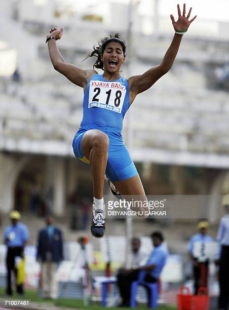 Indian long jumper Anju Bobby George leaps in the air during the women's Long Jump event at the second leg of the Asian Grand Prix in Bangalore 22...