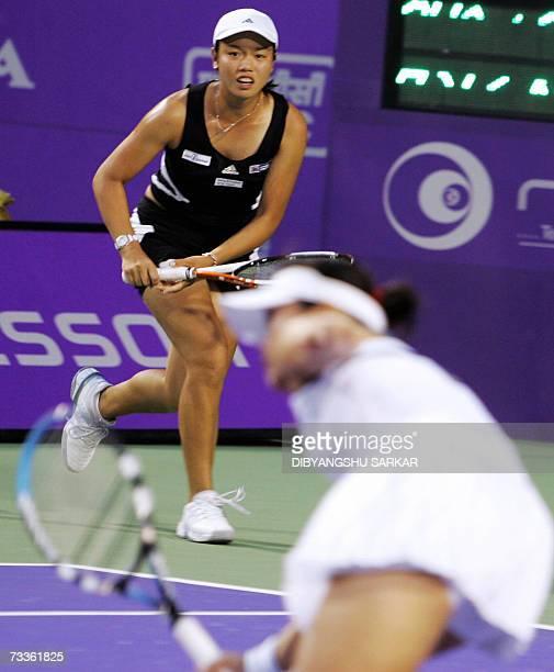 Taipei tennis player YungJan Chan looks on as her partner Taipei's ChiaJung Chuang plays a shot against their opponents Taipein SuWei Hsieh and...