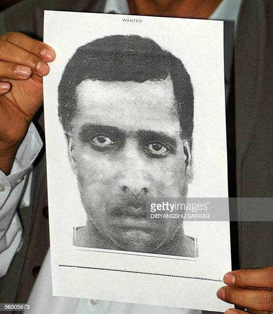 The city police commissioner Ajay Kumar Singh holds a sketch of the suspected gunman who opened fire in the Indian Institute of Science in Bangalore...