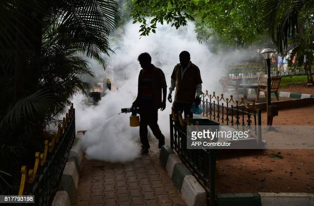 A Bangalore municipal workers fumigate a park in a bid to kill off mosquitos in Bangalore on July 18 2017 Over 18700 cases of dengue have been...