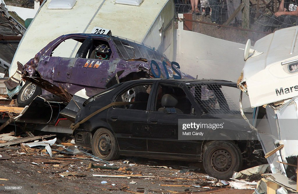 A banger racer looks from his car that his just crashed into a wreckage of old caravans destroyed in the annual Cornish Caravan Chaos at United Downs...