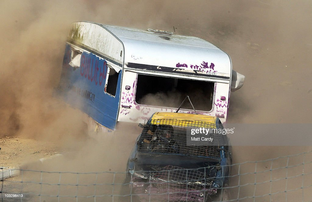 Banger racers towing old caravans compete in the annual Cornish Caravan Chaos at United Downs Raceway on August 8 2010 near Redruth England The...