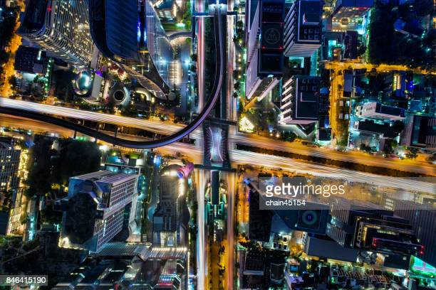 Bangkok aerial top view with traffic jam for transportation in business building area. Bangkok is the most populated city in Southeast Asia.