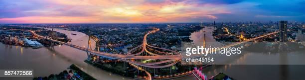 Bangkok city aerial view by panorama with Beautiful Bridge and river landscapes bird's eye view during sunset big sun in Bangkok Thailand.