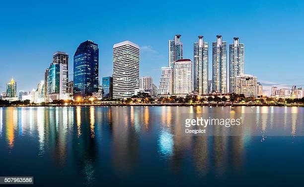 Bangkok City skyline at Benjakiti Park at twilight, Thailand
