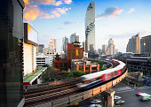 BTS skytrain and Mahanakhon building in background at Bangkok business's district at silom road, Bangkok Thailand