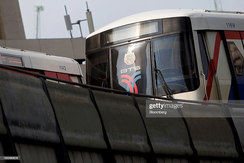 A Bangkok Mass Transit System Pcl SkyTrain, a unit of BTS Group Holdings Pcl, passes another train as they moves along an elevated track above Sathorn Road in central Bangkok, Thailand, on Thursday, April 4, 2013. The BTS Rail Mass Transit Growth Infrastructure Fund, backed by Bangkok's SkyTrain, raised about 62.5 billion baht ($2.1 billion) in Thailand's biggest initial public offering. Photographer: Dario Pignatelli/Bloomberg via Getty Images