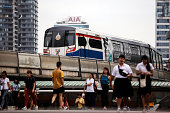 A Bangkok Mass Transit System Pcl SkyTrain a unit of BTS Group Holdings Pcl travels on an elevated track in Bangkok Thailand on Friday Aug 15 2014...